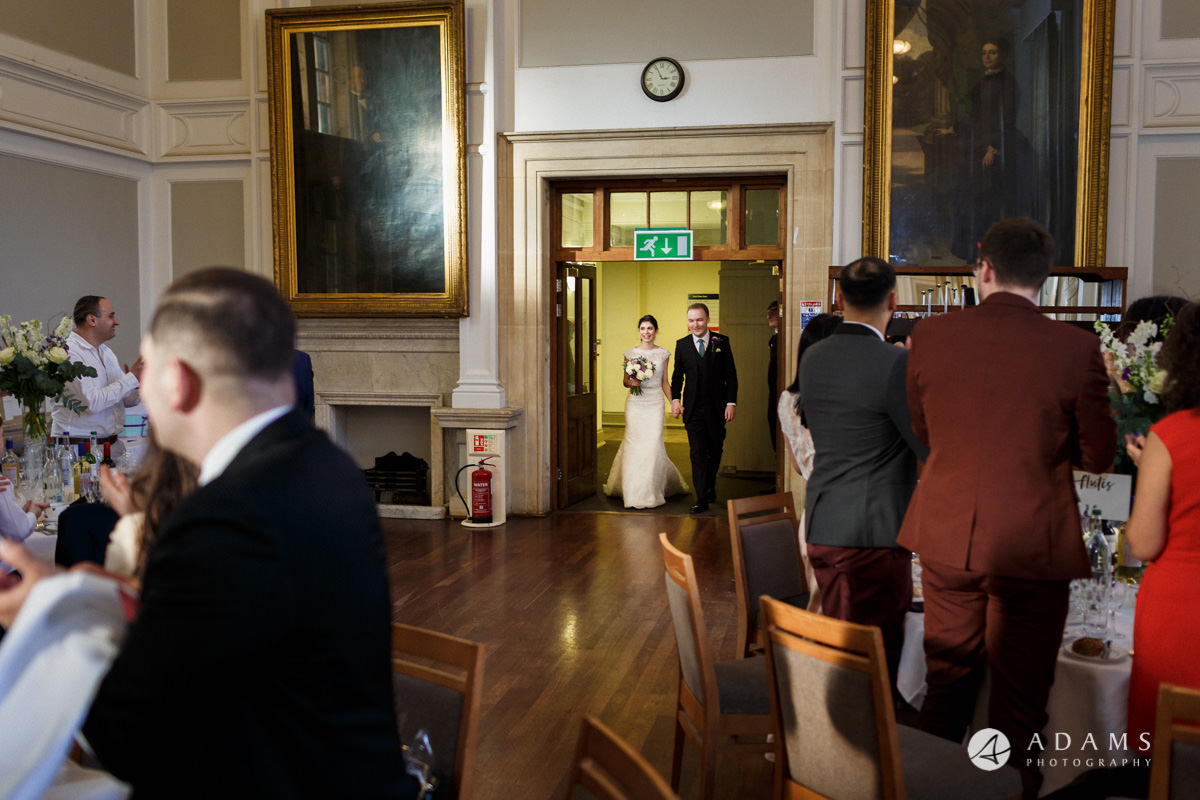 royal holloway wedding bride and groom enter the room