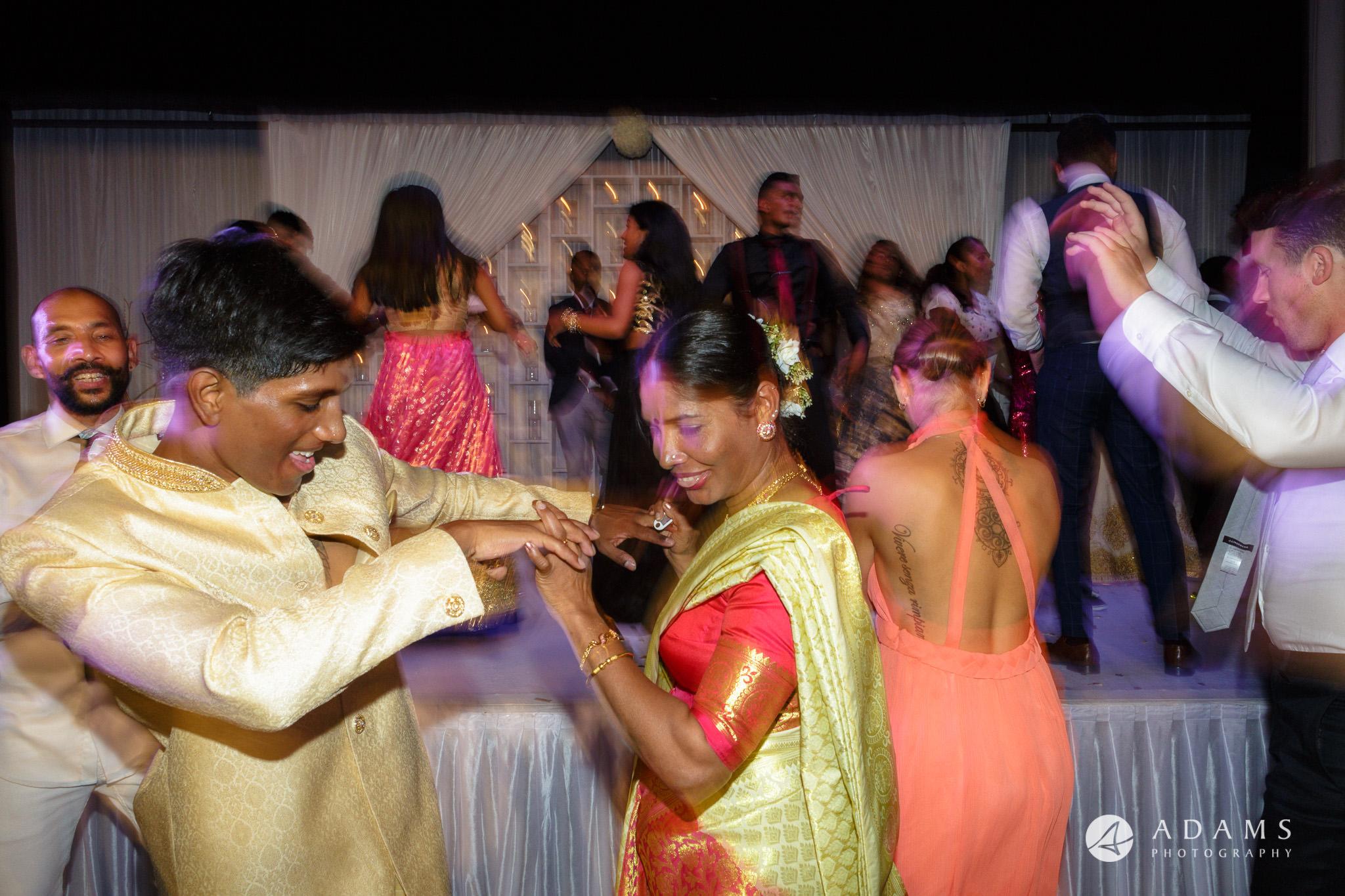 Oslo Wedding Photo groom dances with his mother