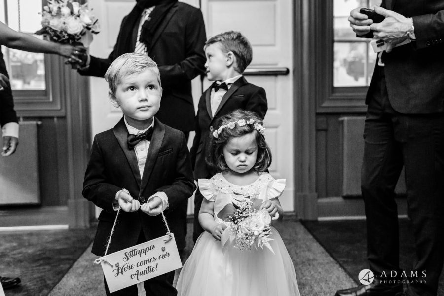Oslo Wedding Photos Norway photo of flower girl and the boy holding here comes the bride sign