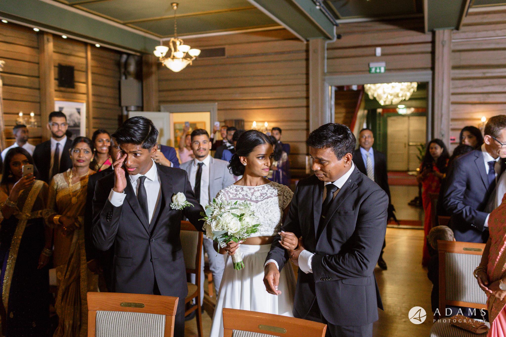 Oslo Wedding Photos Norway photo of groom having teats in his eyes