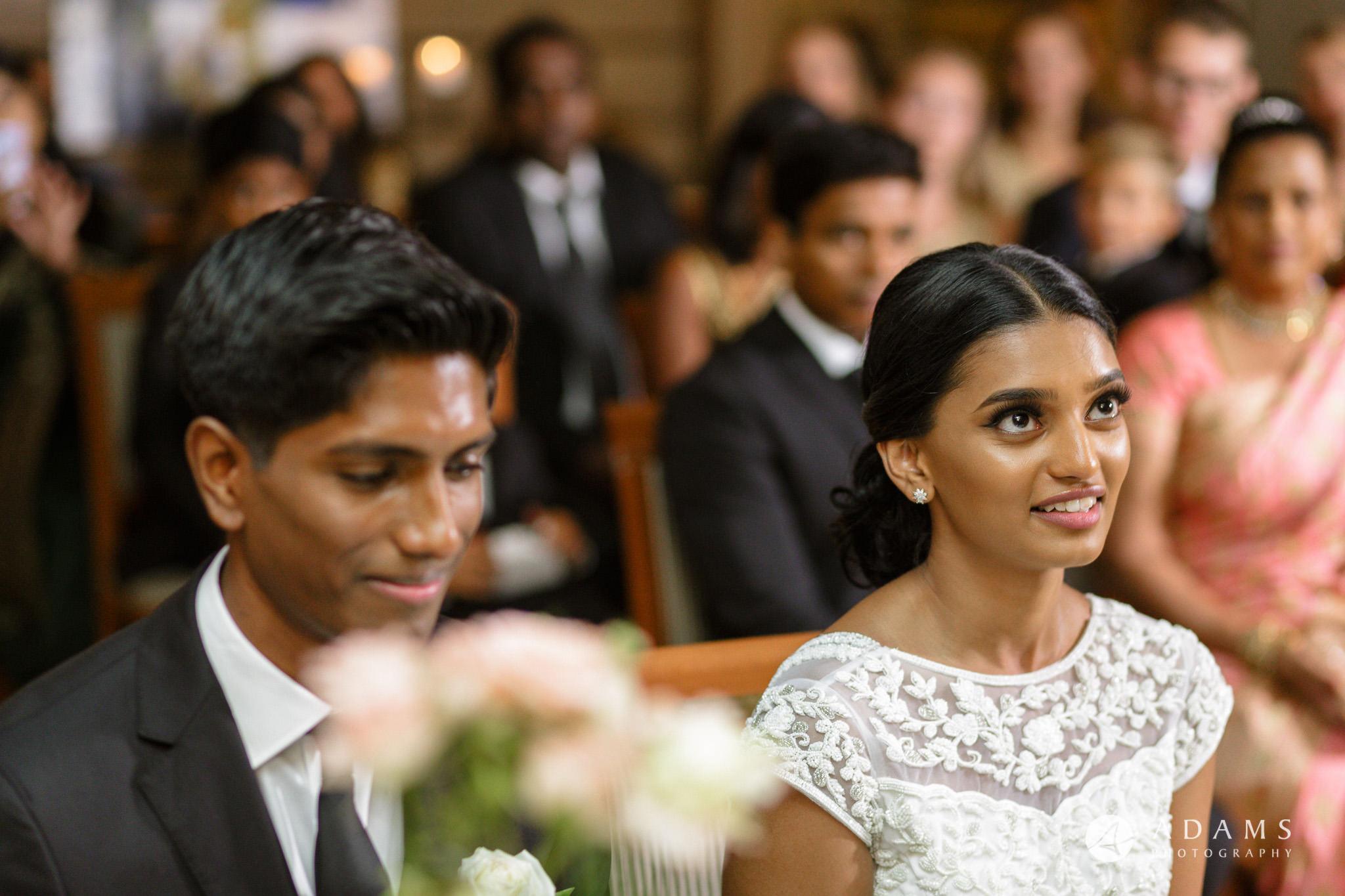 Oslo Wedding Photographer Norway couple sitting during the ceremony