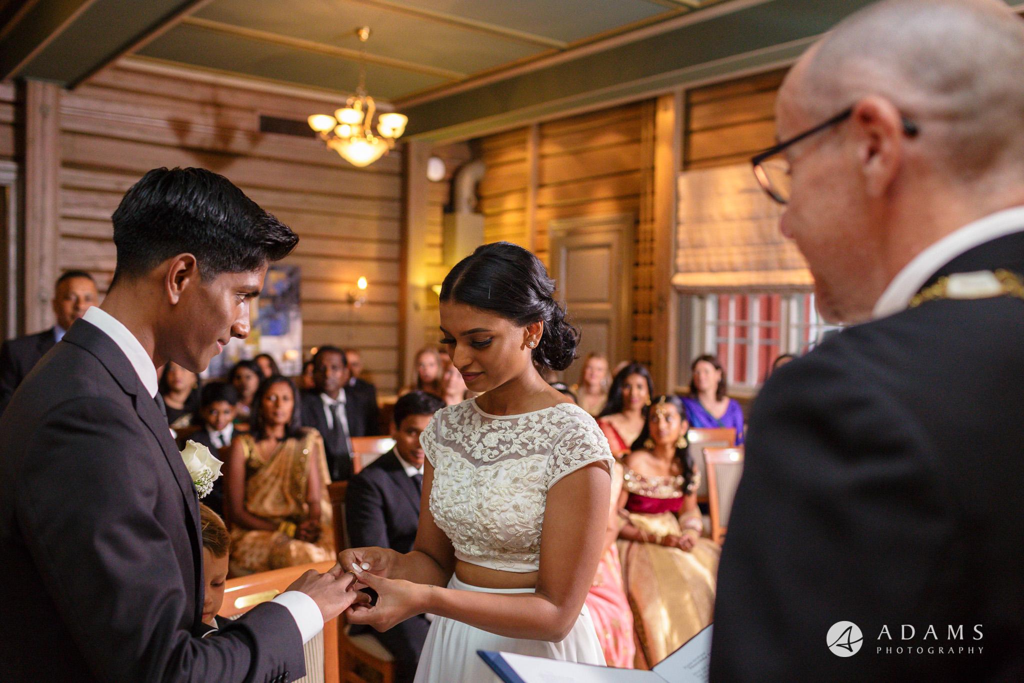 Oslo Wedding couple exchange the rings