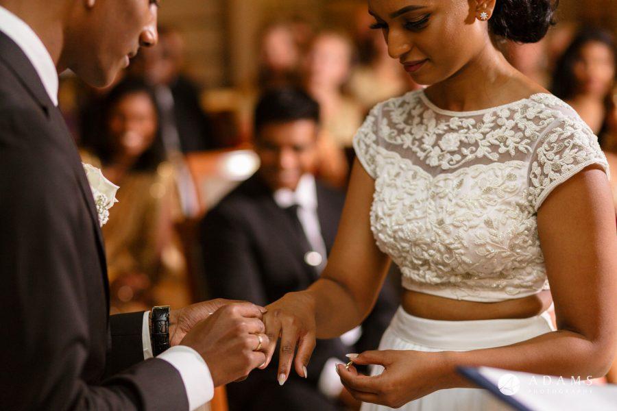 Oslo Wedding groom puts the ring on bride finger