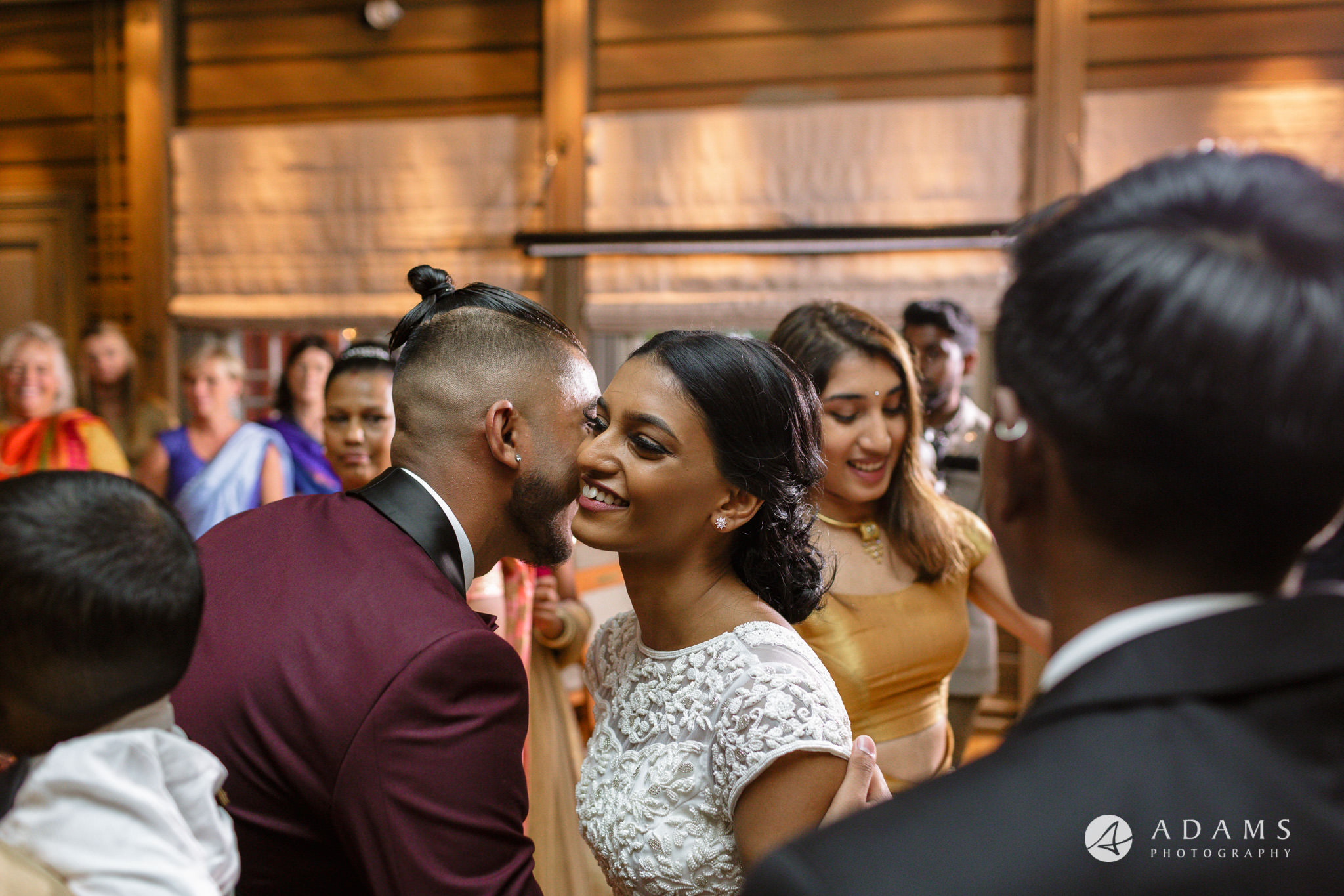Oslo Wedding bride kisses the guest