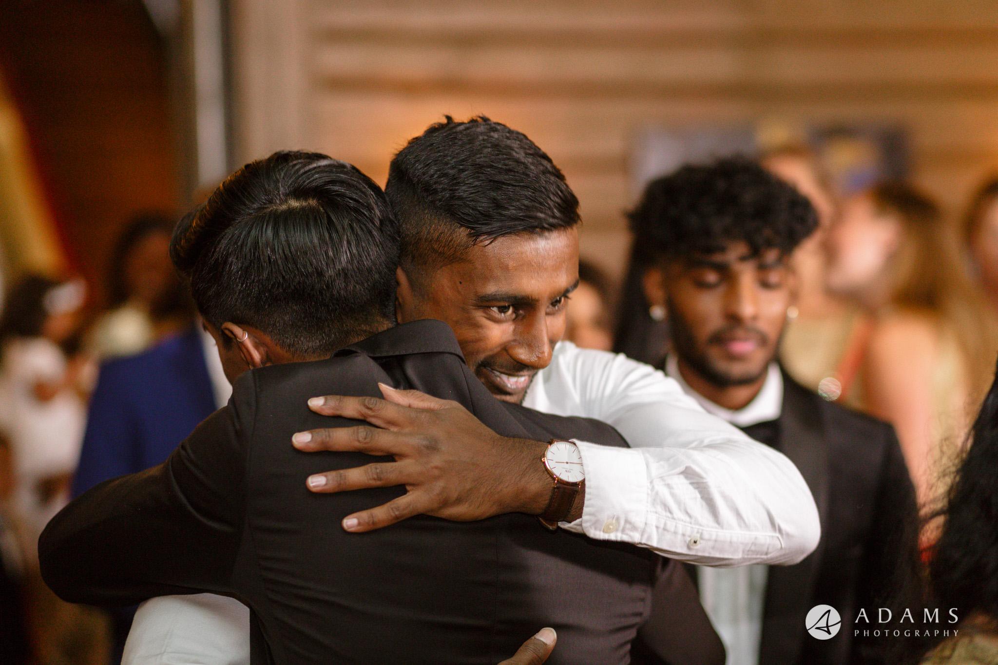 Oslo Wedding bestman hug