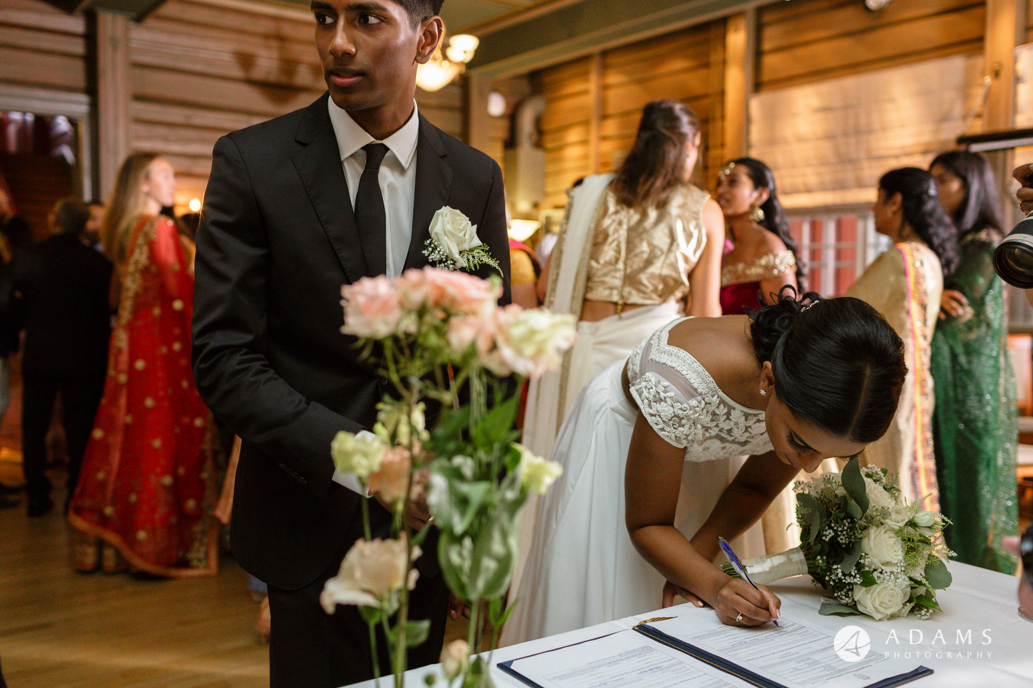 Oslo Wedding Photography couple signing the registrar
