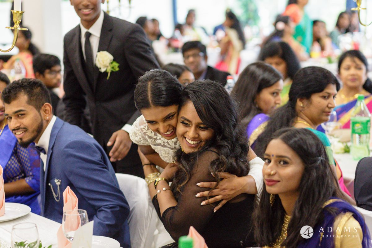 Norway Tamil Wedding guests hugging the bride