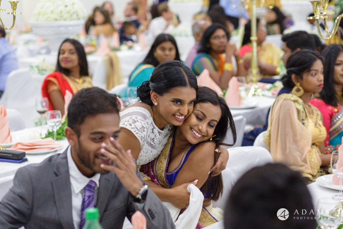 Norway Tamil Wedding bride hugs the guest