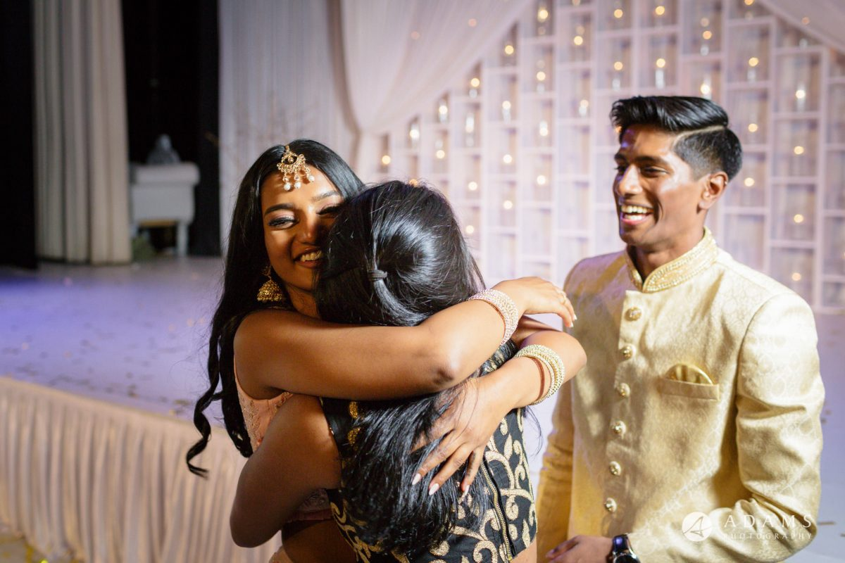 Oslo Tamil Wedding bride hugs a freind