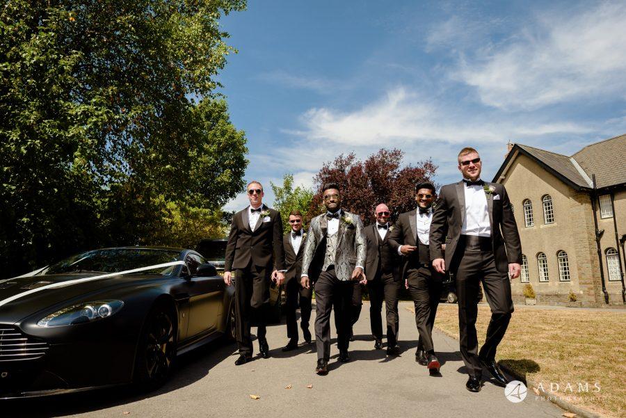st donats castle wedding groom and his groomsmen walking