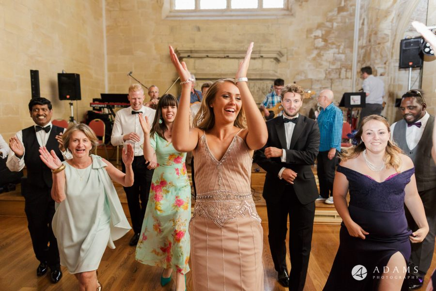 st donats castle wedding bridesmaid is dancing and clapping her hands