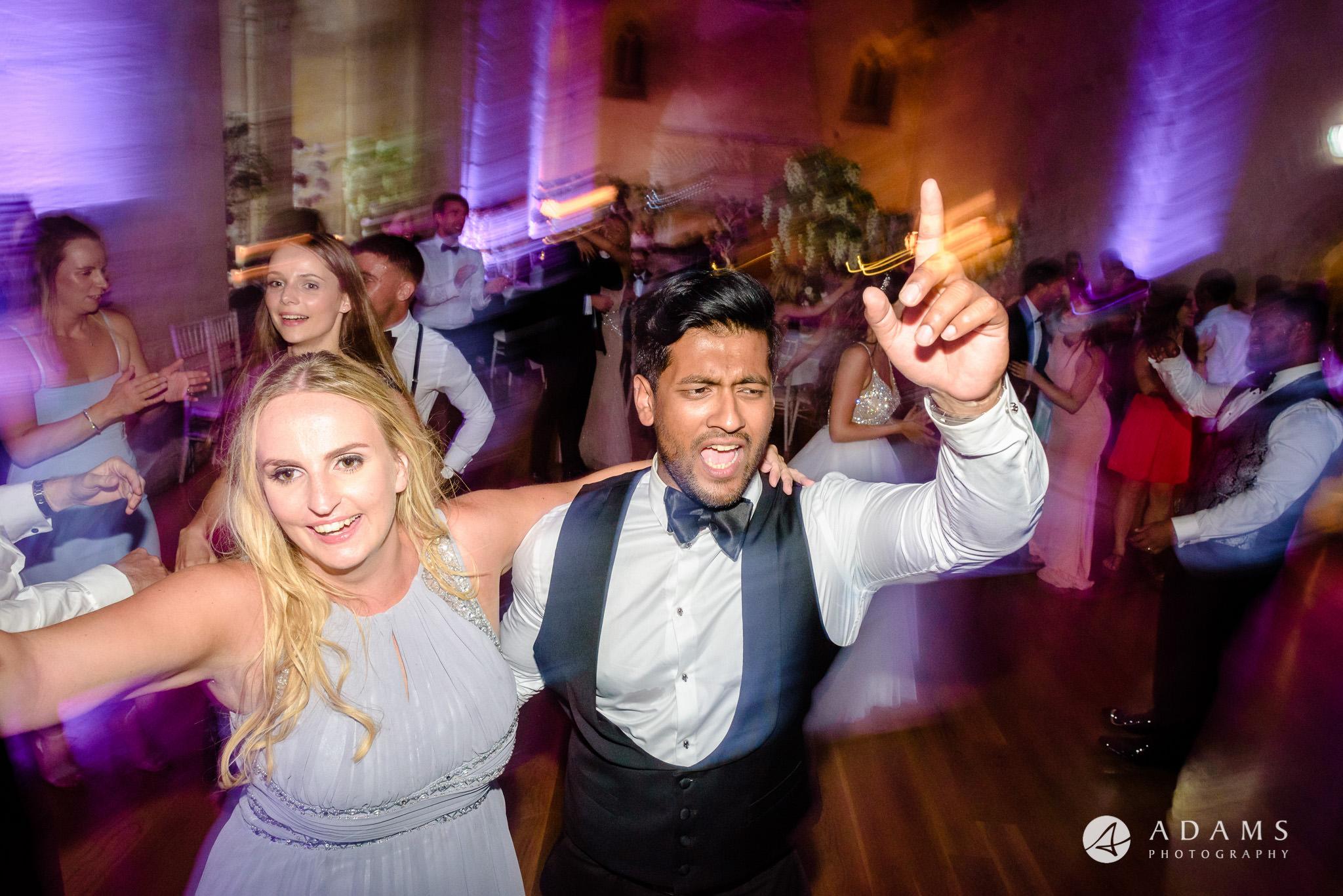 st donats castle wedding guests rising hands