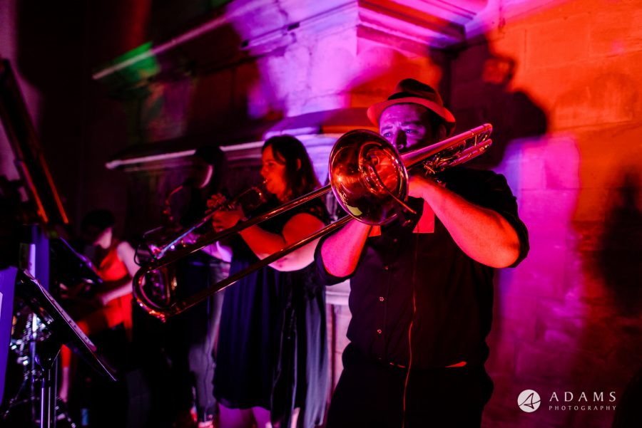 st donats castle wedding band is playing the trumpet
