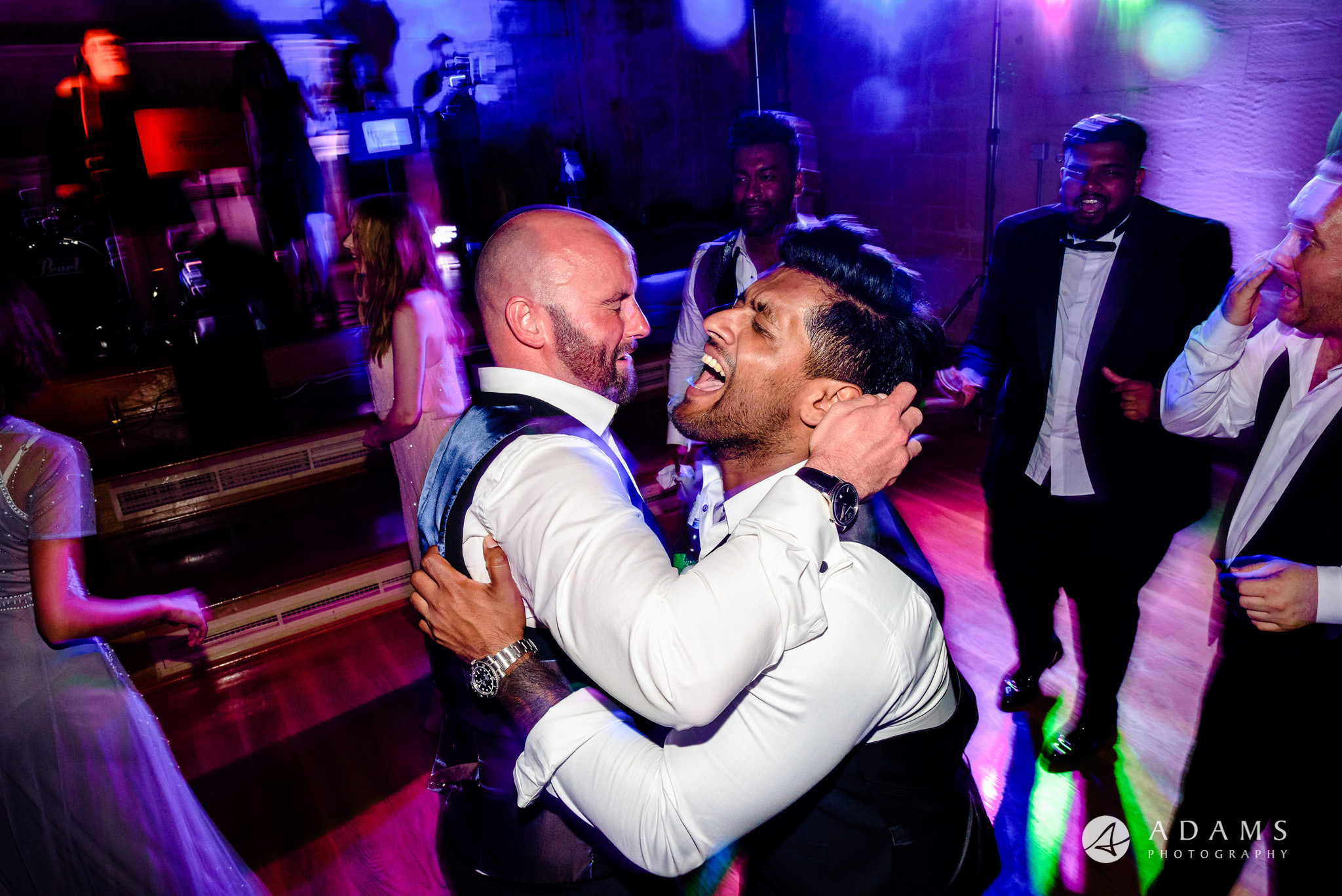 st donats castle wedding grooms brother is hugging his friend