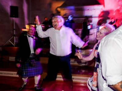 st donats castle wedding guest is jumping