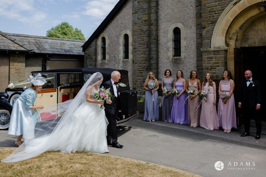 st donats castle wedding bride walks with her father