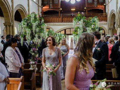 st donats castle wedding bridesmaids walking down the aisle