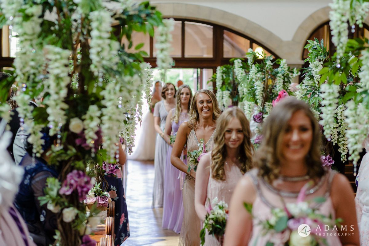 st donats castle wedding bridesmaids walking down the aisle close up