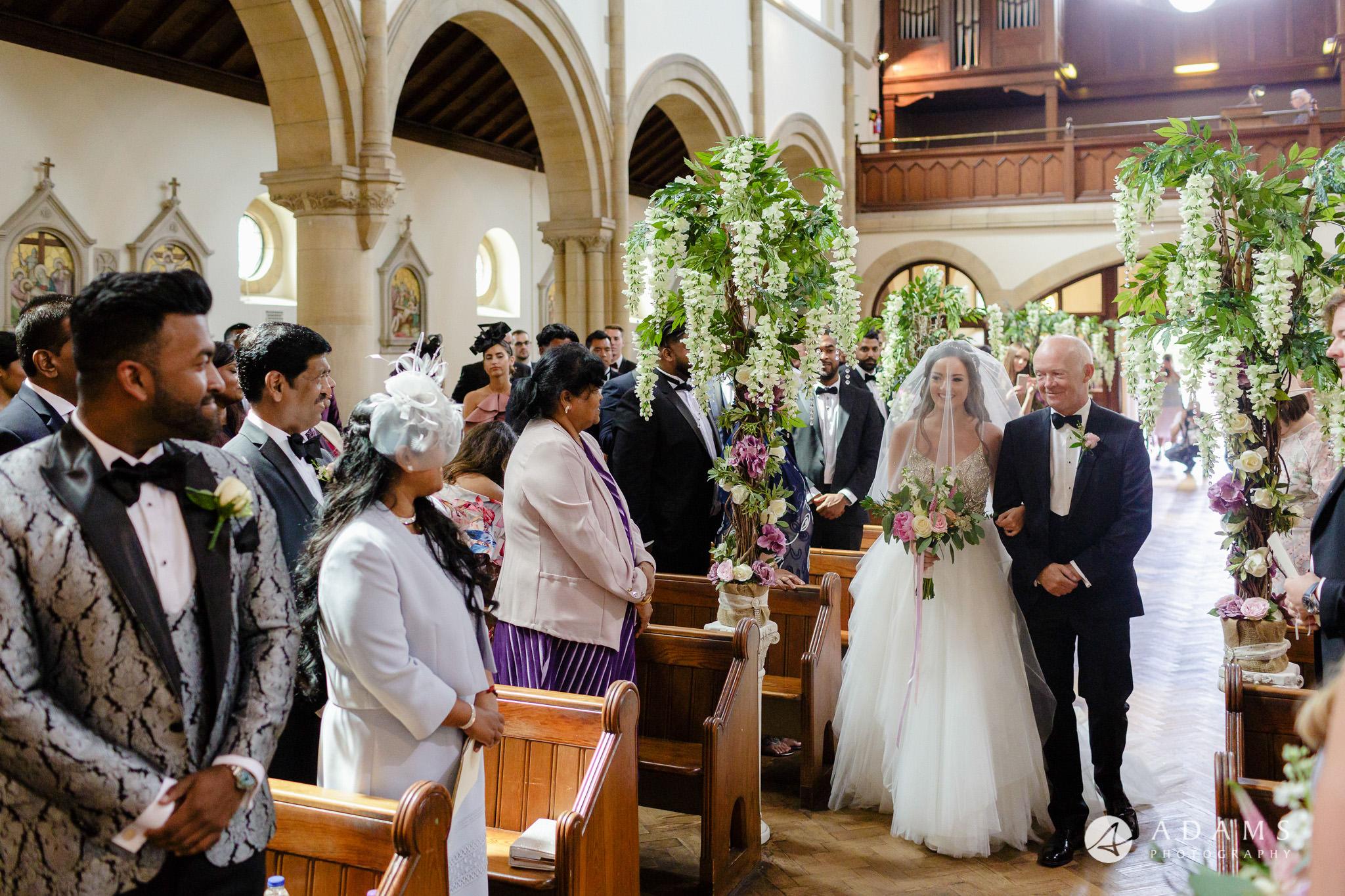 st donats castle wedding bride walking down the aisle