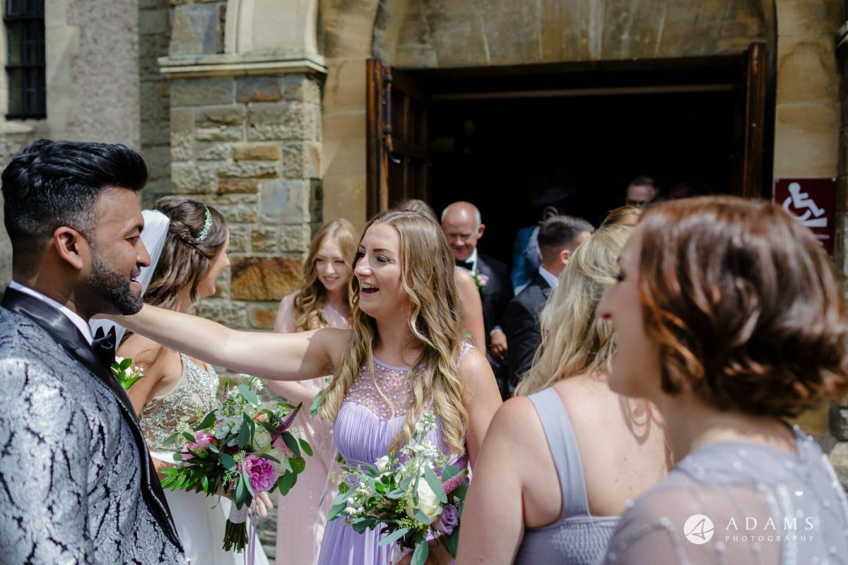 st donats castle wedding bridesmaid hugging groom
