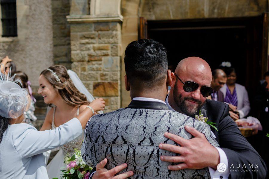 st donats castle wedding guests hugging