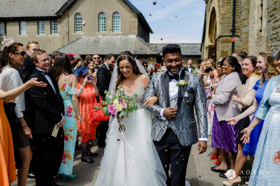 st donats castle wedding smiling after confetti shot