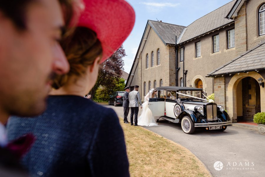 st donats castle wedding bride and groom are getting into the car