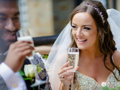 st donats castle wedding grooms and bride drinking champagne