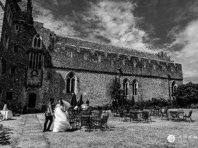 st donats castle wedding the couple is standing in from of the castle