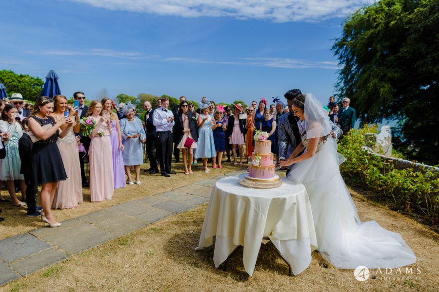 st donats castle wedding cutting the cake