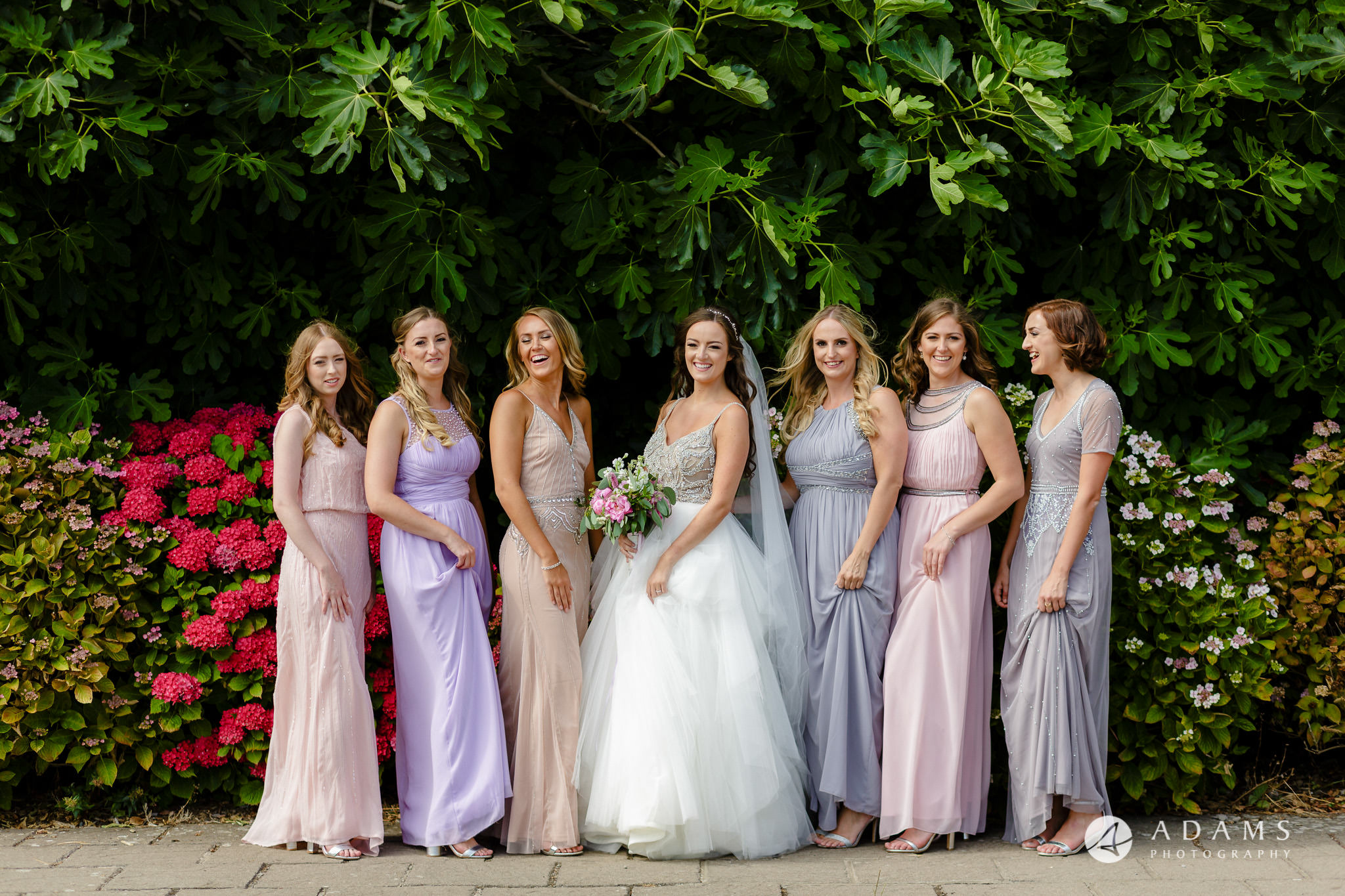 st donats castle wedding bride and her bridesmaids are having a group shot