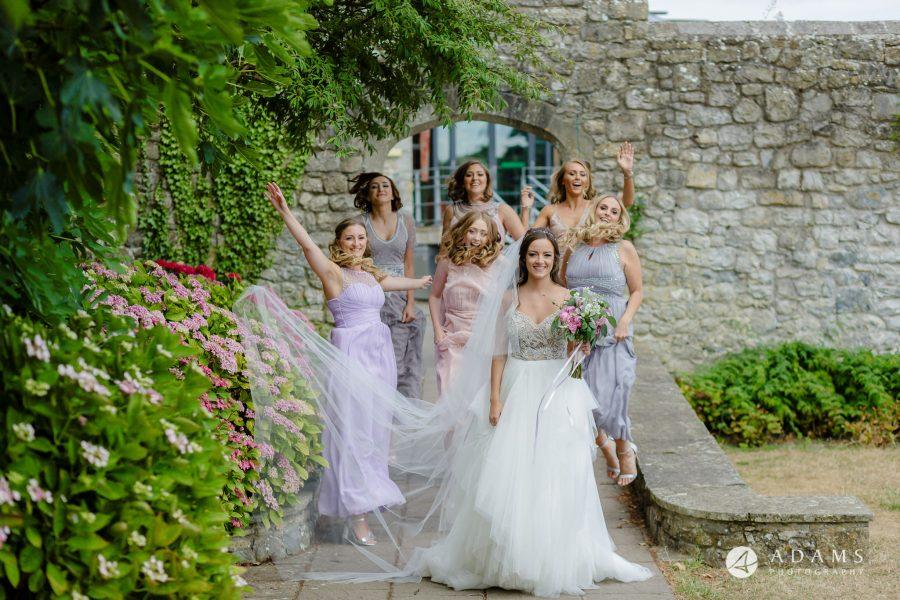 st donats castle wedding bridesmaids jumping