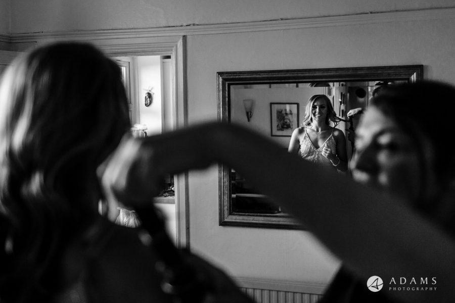 st donats castle wedding bridesmaid looking in the mirror