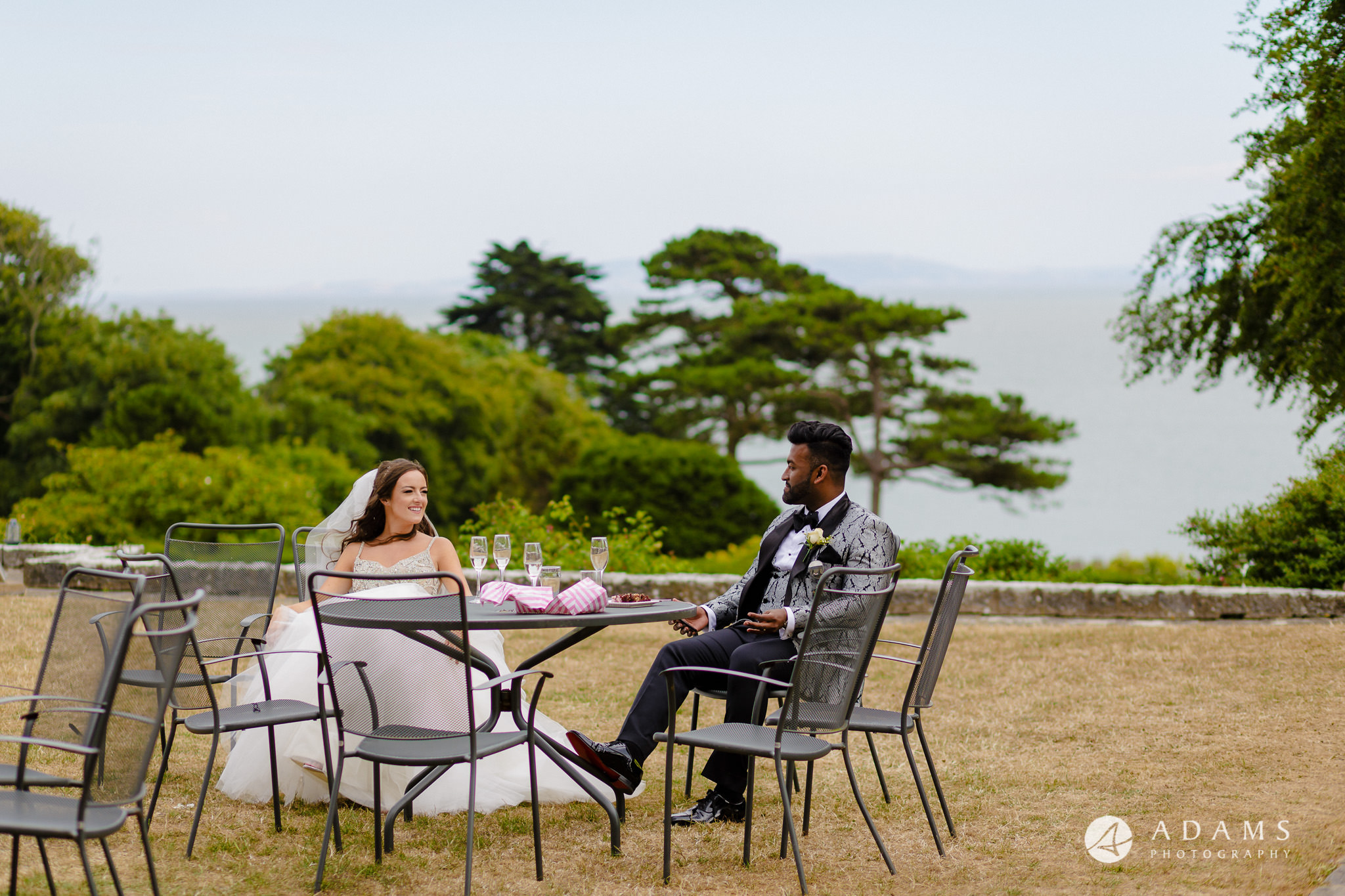 st donats castle wedding bride and groom are resting on the chairs outside the castle
