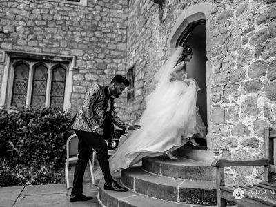 st donats castle wedding married couple is entering the castle
