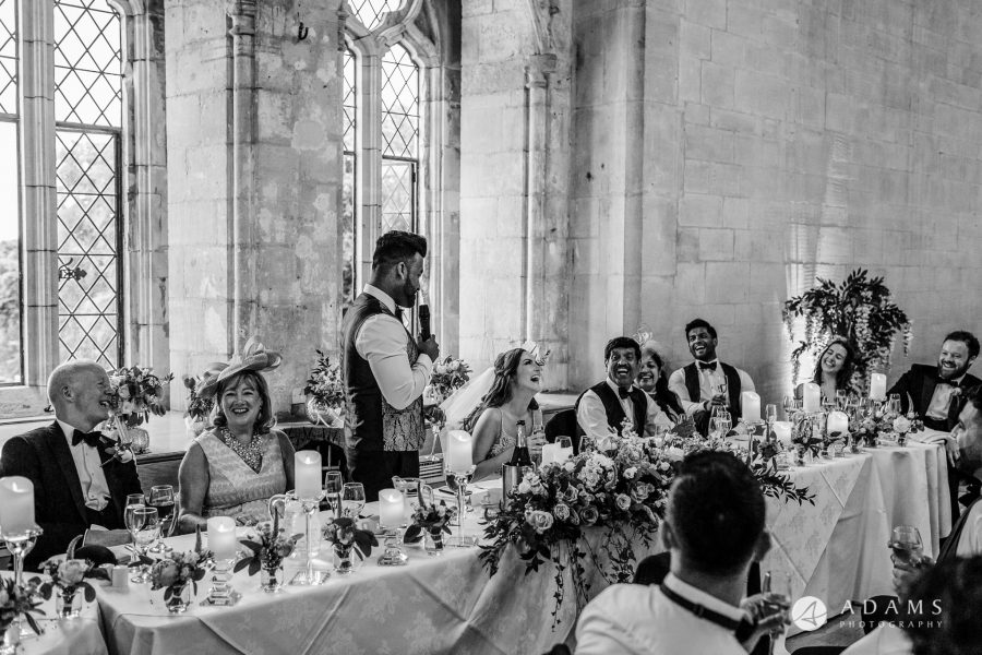 st donats castle wedding groom is looking at the bride when he is delivering his speech