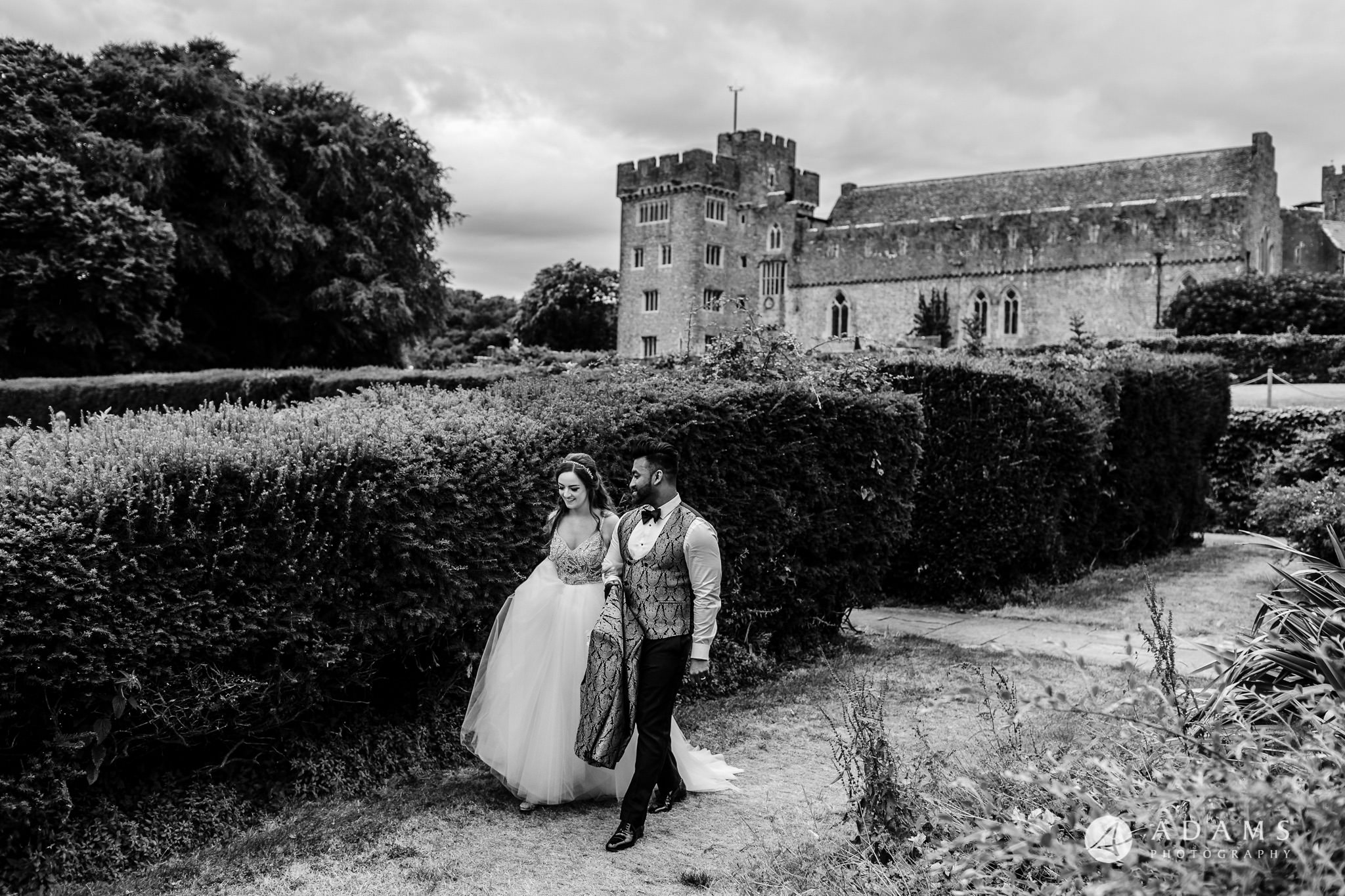 st donats castle wedding bride and groom walks in front of the castle