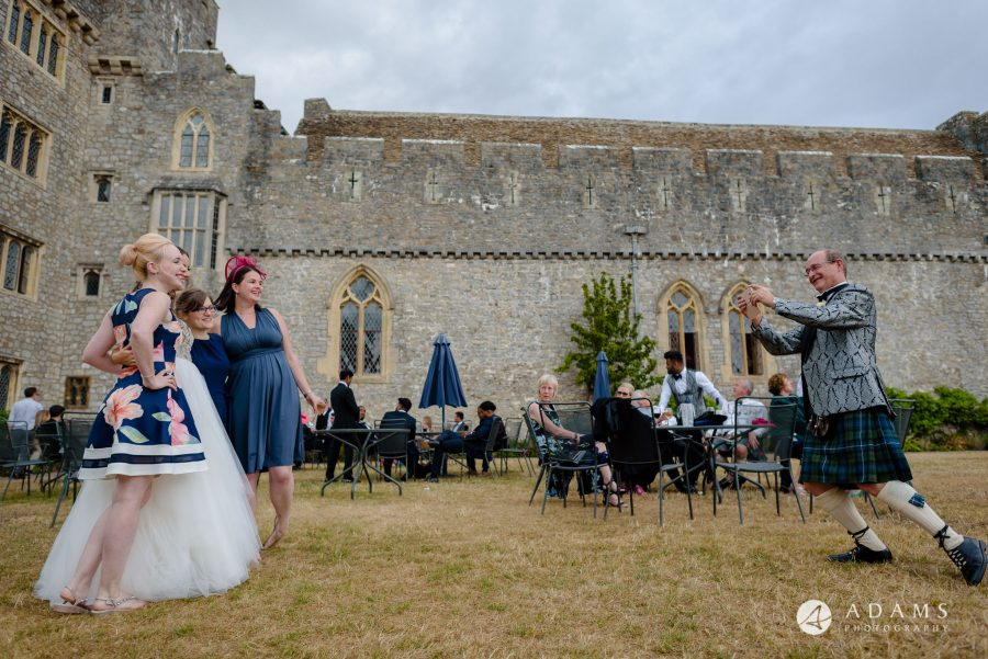 st donats castle wedding guests are having a good time outside the castel