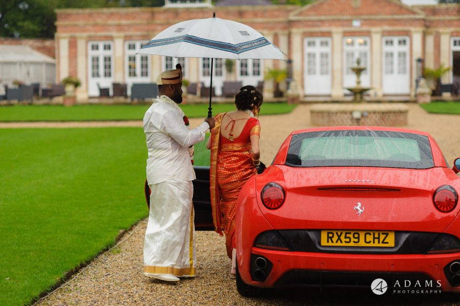 walled garden orchardleigh wedding the married couple are getting into the car