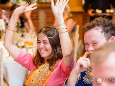 walled garden orchardleigh wedding bridesmaid holding ehr hand up in the aire