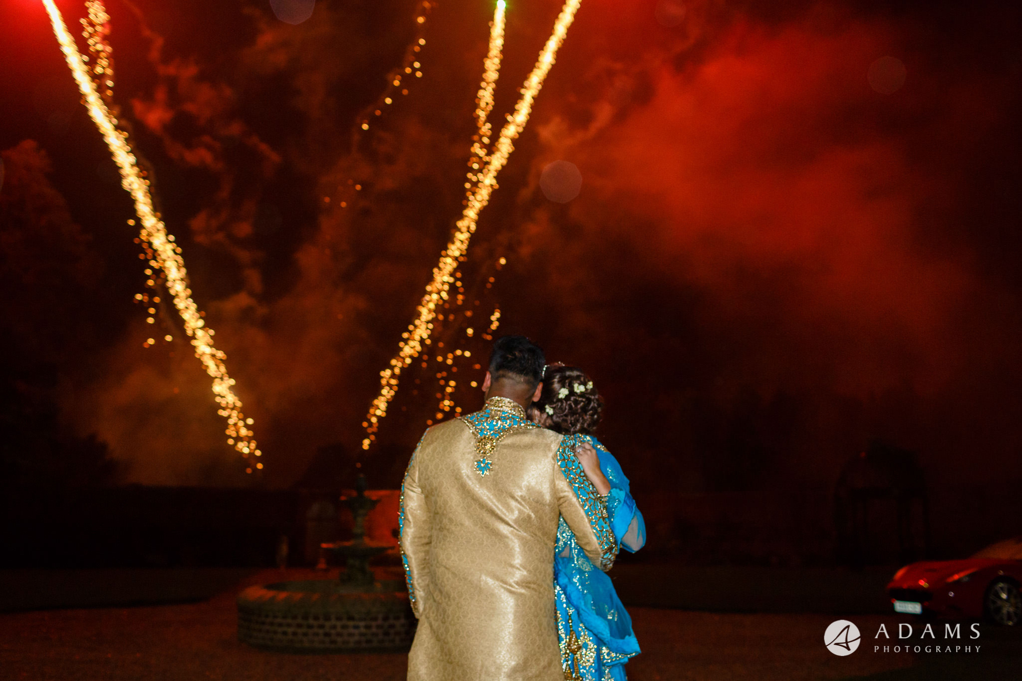 walled garden orchardleigh wedding the couple looks at the fireworks