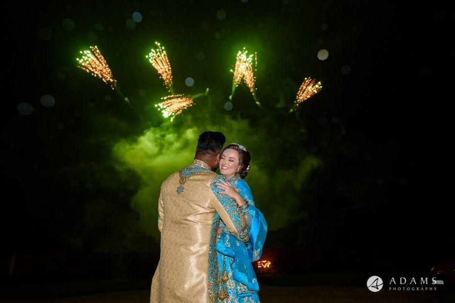 walled garden orchardleigh wedding the couple hugs in front of the fireworks