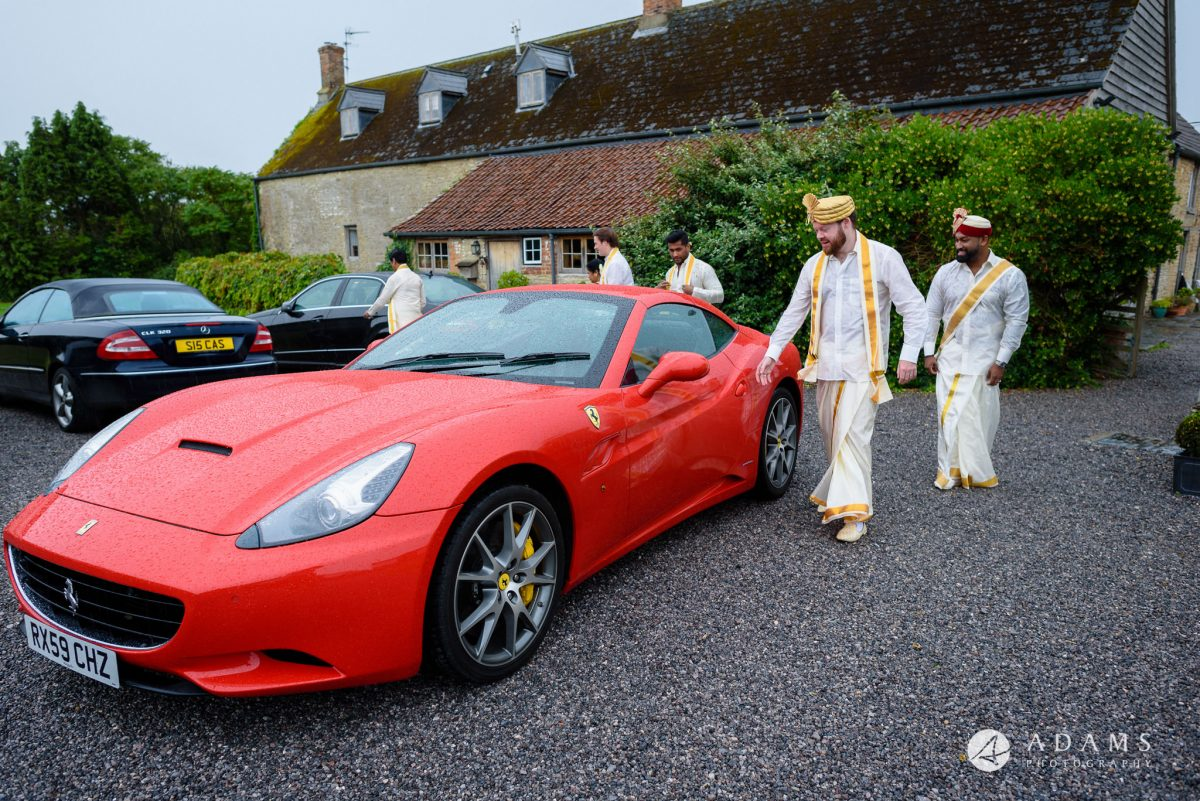 walled garden orchardleigh wedding groom and groomsmen are getting into the car