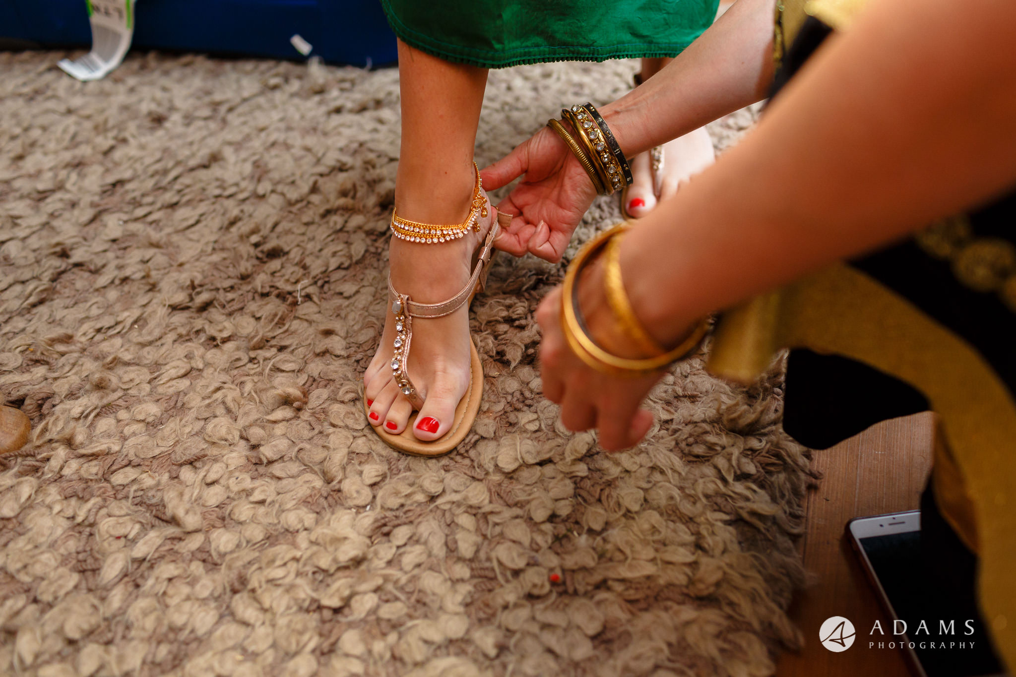walled garden orchardleigh wedding bride is putting her shoes on