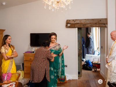 walled garden orchardleigh wedding bride is putting sari