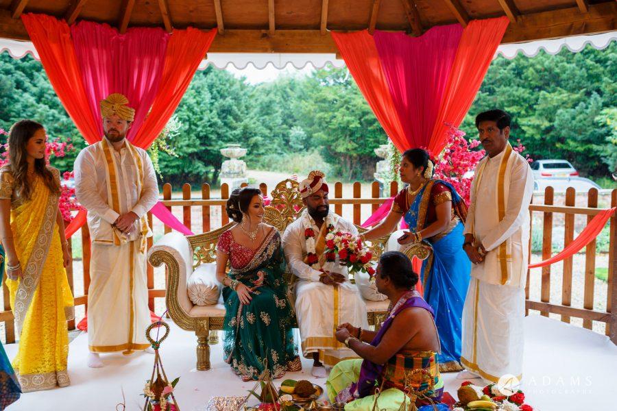 walled garden orchardleigh wedding bride sitting next to groom