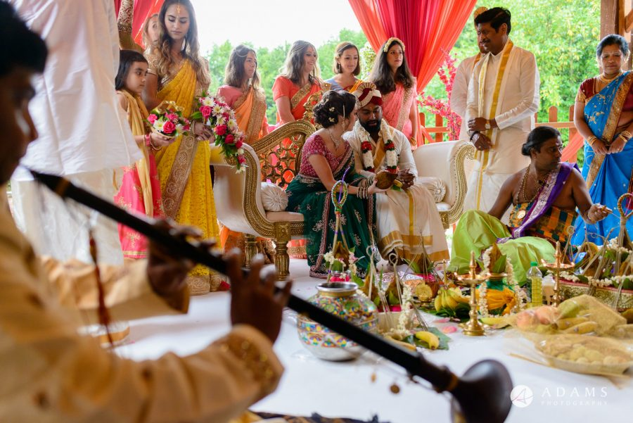 walled garden orchardleigh wedding bride and groom during the tamil ceremony