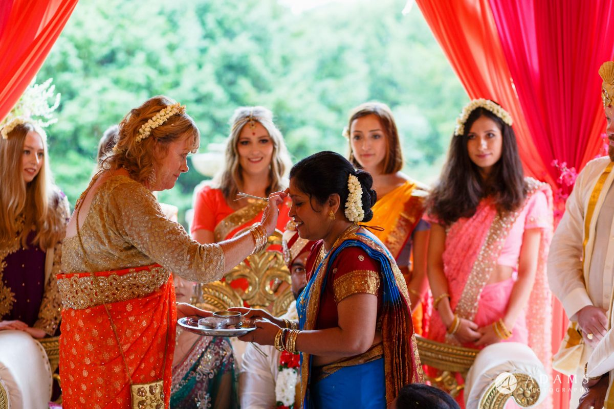 walled garden orchardleigh wedding mothers at tamil wedding ceremony