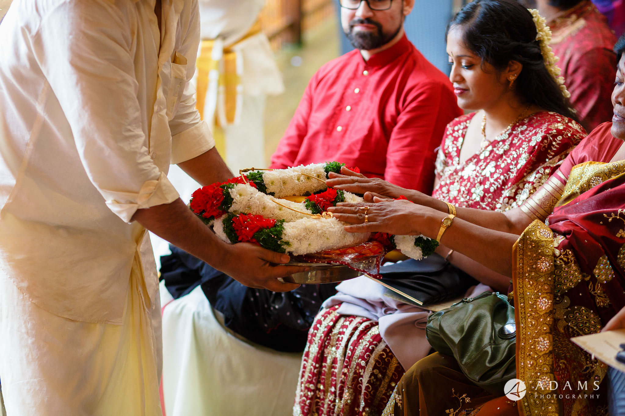 walled garden orchardleigh wedding family and guests are blessing the thali