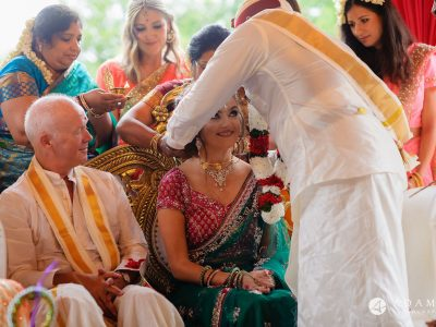 walled garden orchardleigh wedding bride is receiving thali close up